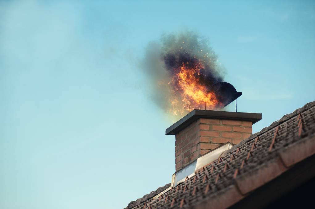 Ash, soot and combustion residue build up can ignite, resulting in flames coming out your chimney, or worse, going into your roof.